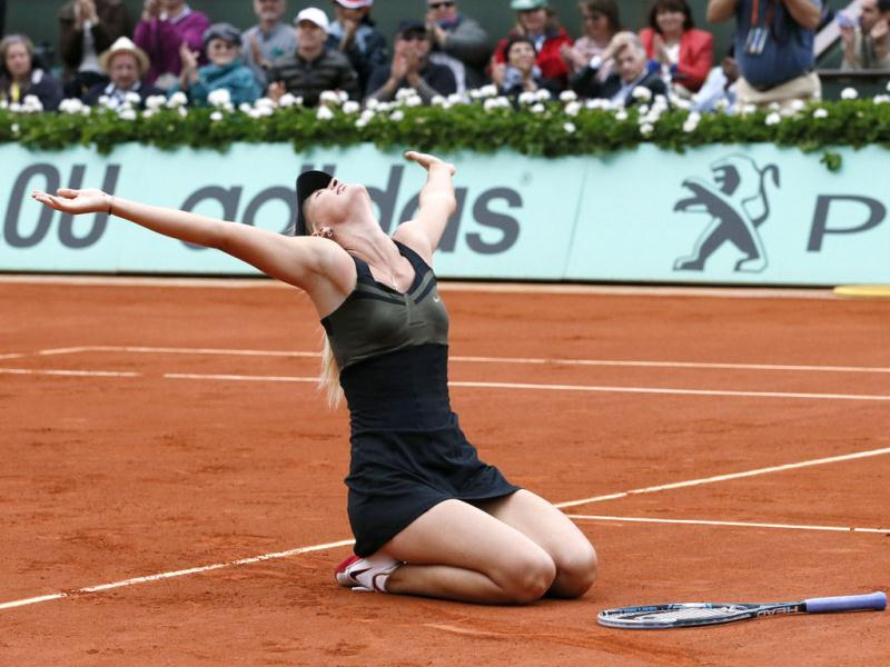 Russia's Maria Sharapova reacts after winning over Italy's Sara Errani during their Women's Singles final tennis match of the French Open tennis tournament at the Roland Garros stadium in Paris. AFP/Patrick Kovarik
