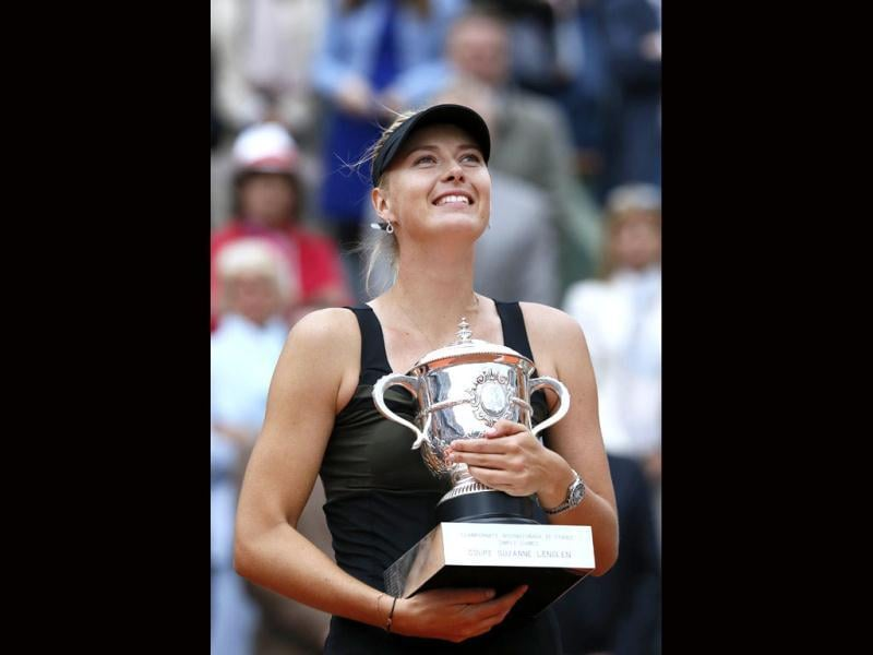 Maria Sharapova holds a trophy after winning over Sara Errani during their Women's Singles final tennis match of the French Open tennis tournament at the Roland Garros stadium in Paris. AFP/Patrick Kovarik