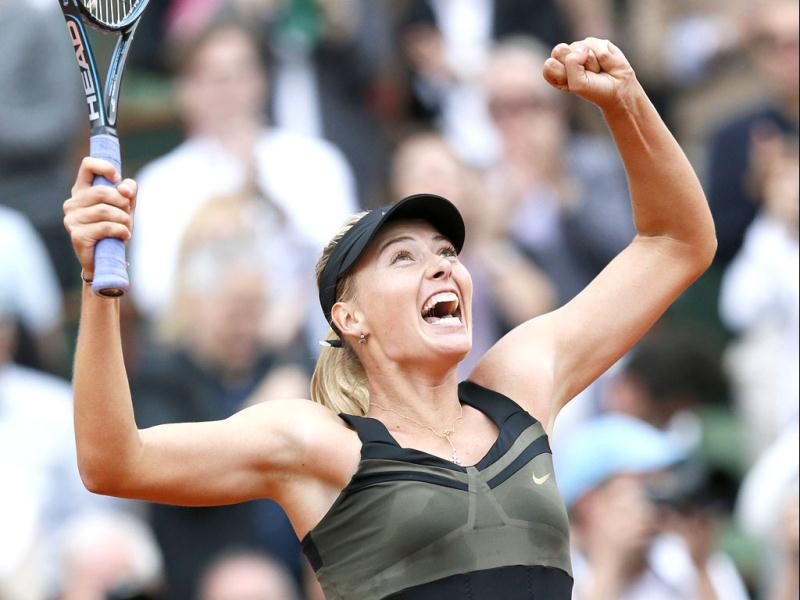 Maria Sharapova reacts after winning against Sara Errani their Women's Singles final tennis match of the French Open tennis tournament at the Roland Garros stadium in Paris.  AFP/Jacques Demarthon