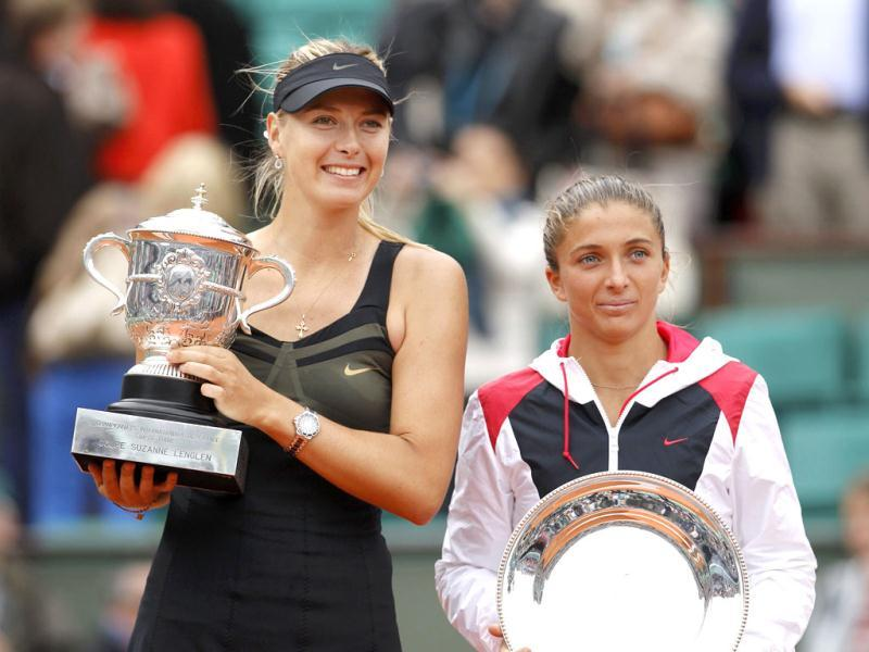 Maria Sharapova holds the trophy as she poses with Sara Errani during the ceremony after winning the women's singles final match at the French Open tennis tournament at the Roland Garros stadium in Paris. Reuters/Benoit Tessier