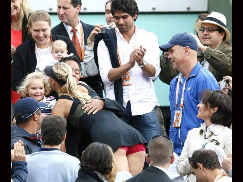 Maria Sharapova reacts in the box of her realatives and friends after winning over Sara Errani during their Women's Singles final tennis match of the French Open tennis tournament at the Roland Garros stadium in Paris. AFP/Patrick Kovarik
