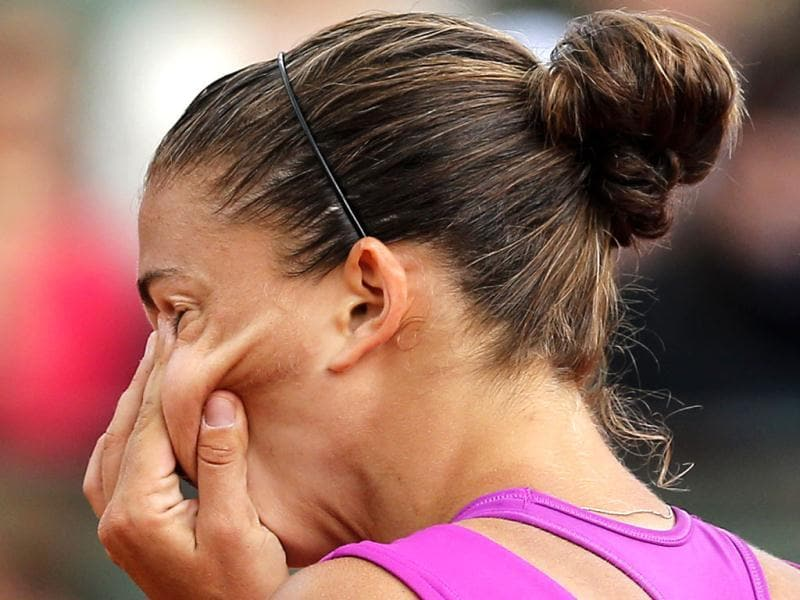 Italy's Sara Errani reacts as she plays Russia's Maria Sharapova during their women's final match in the French Open tennis tournament at the Roland Garros stadium in Paris. AP/Michel Euler