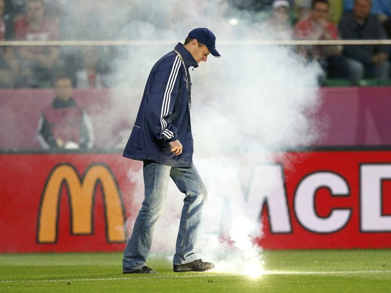 A steward removes a flare from the pitch which was thrown by a supporter from the stands during the Group A Euro 2012 soccer match between Russia and Czech Republic at the city stadium in Wroclaw. Reuters/Sergio Perez