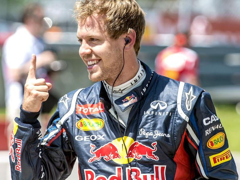 Red Bull Racing Renault driver Sebastian Vettel of Germany gestures after finishing first in the qualifying session at the Circuit Gilles Villeneuve in Montrealfor the Canadian Formula One Grand Prix. (AFP Photo)