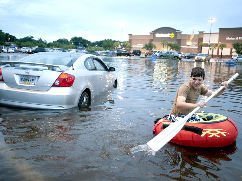 A resident makes his way through a parking lot in the Warrington area of Pensacola Florida. A storm moving across the US Gulf Coast battered parts of Alabama and Florida with up to 18 inches of rain on Saturday with authorities declaring a state of emergency. (Reuters)