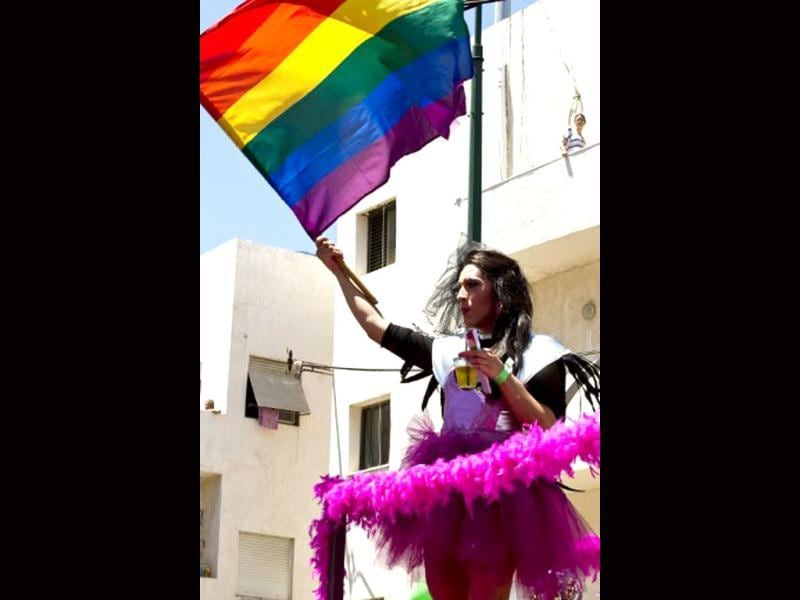 An Israeli drag queen waves a rainbow-coloured flag at the opening of the annual Gay Pride parade, where tens of thousands flooded the streets, in the Mediterranean city of Tel Aviv. AFP Photo/Jack Guez