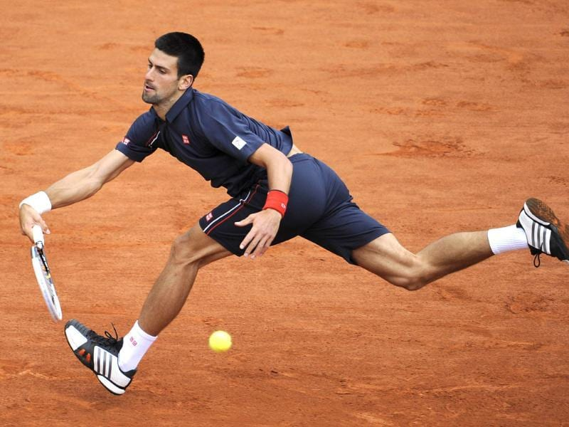 Serbia's Novak Djokovic hits a return to Spain's Rafael Nadal during their Men's Singles final tennis match of the French Open tennis tournament at the Roland Garros stadium, in Paris.  AFP Photo/Pascal Guyot
