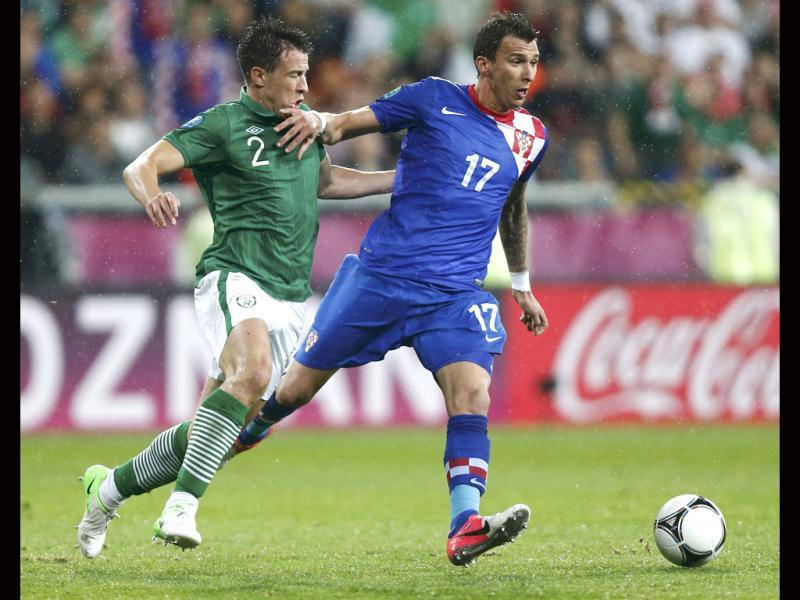 Croatia's Mario Mandzukic is challenged by Ireland's Sean St Ledger during their Group C Euro 2012 soccer match at the City stadium in Poznan. Reuters/Dominic Ebenbichler