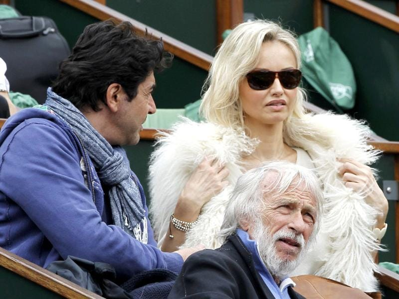 Model Adriana Karembeu (R) and actor Pierre Richard (C) attend the men's singles final match between Rafael Nadal of Spain and Novak Djokovic of Serbia during the French Open tennis tournament at the Roland Garros stadium in Paris Reuters/Gonzalo Fuentes