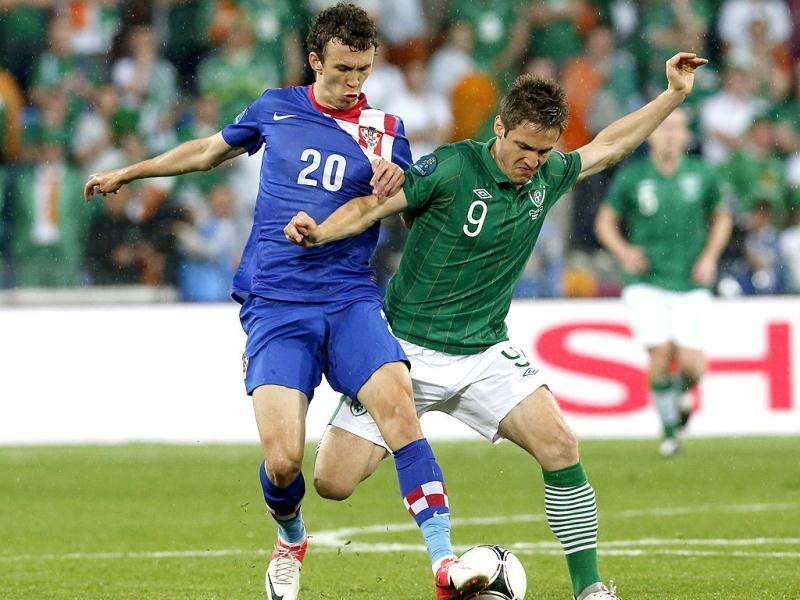 Croatia's Ivan Perisic and Ireland's Kevin Doyle, right, challenge for the ball during the Euro 2012 soccer championship Group C match between the Republic of Ireland and Croatia in Poznan, Poland. AP/Antonio Calanni