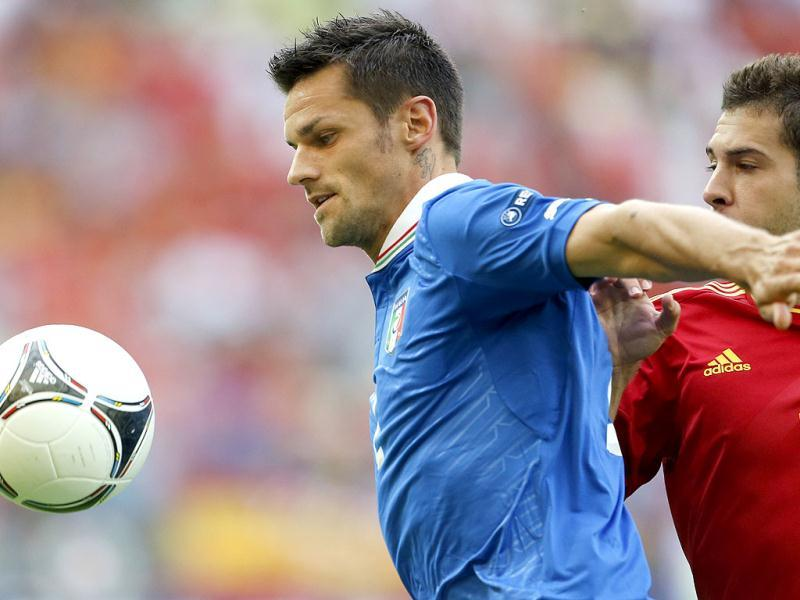 Italy's Cristian Maggio, left, takes the ball away from Spain's Jordi Alba during the Euro 2012 soccer championship Group C match between Spain and Italy in Gdansk, Poland. AP/Gregorio Borgia