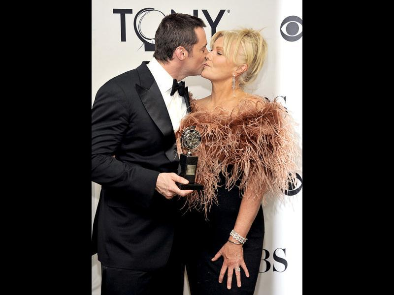 Hugh Jackman kisses wife Deborra-Lee Furness at the 66th Annual Tony Awards in New York. AP/Invision/Evan Agostini