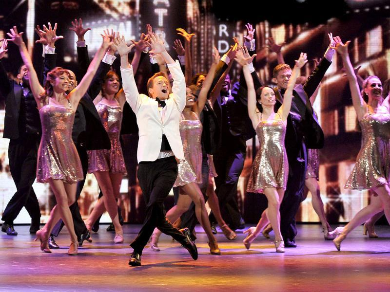 Neil Patrick Harris led the audience quite a fine dance at the Tony awards, 2012. (AP)