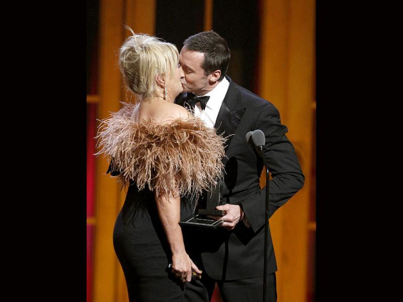 Hugh Jackman kisses his wife, Deborra-Lee Furness (L), after she presented him a special Tony award during the American Theatre Wing's 66th annual Tony Awards in New York June 10, 2012. (Reuters)