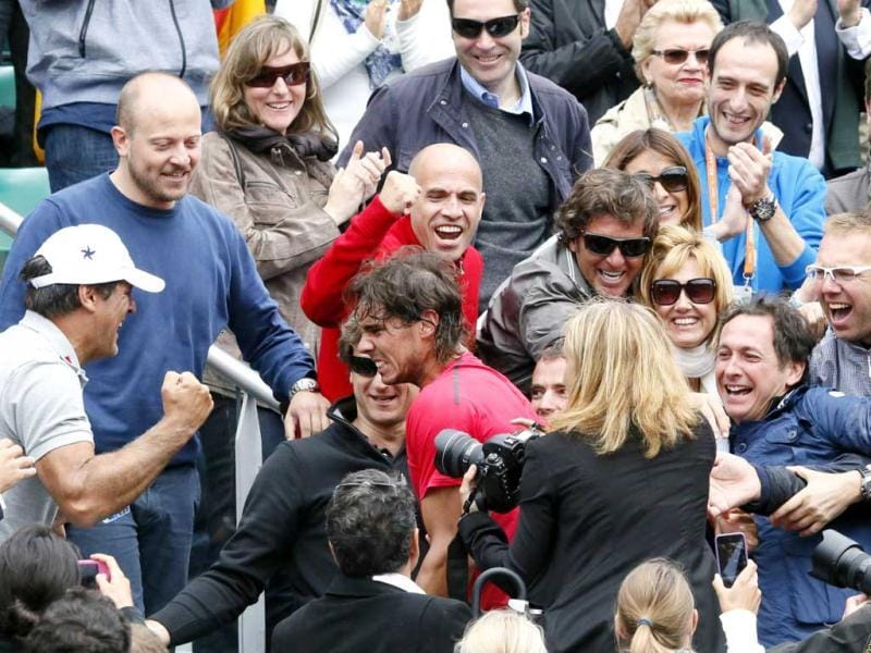 Spain's Rafael Nadal greets his staff members and his family after winning against Serbia's Novak Djokovic their Men's Singles final tennis match of the French Open tennis tournament at the Roland Garros stadium in Paris. AFP Photo/Patrick Kovarik