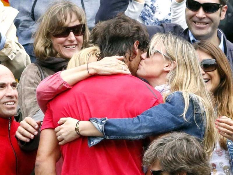 Spain's Rafael Nadal celebrates with his sister after winning against Serbia's Novak Djokovic their Men's Singles final tennis match during the French Open tennis tournament at the Roland Garros stadium in Paris. AFP Photo/Patrick Kovarik
