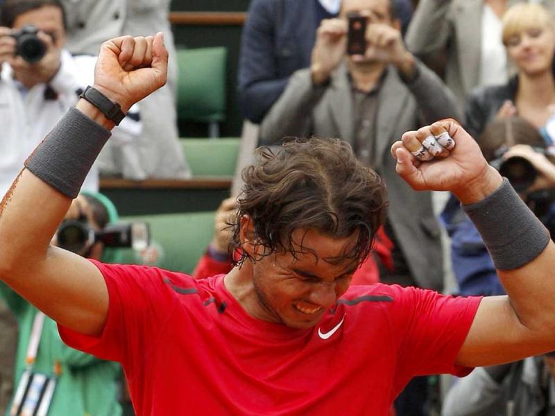 Rafael Nadal of Spain reacts after winning the men's singles final match against Novak Djokovic of Serbia at the French Open tennis tournament at the Roland Garros stadium in Paris. Reuters Photo/Gonzalo Fuentes
