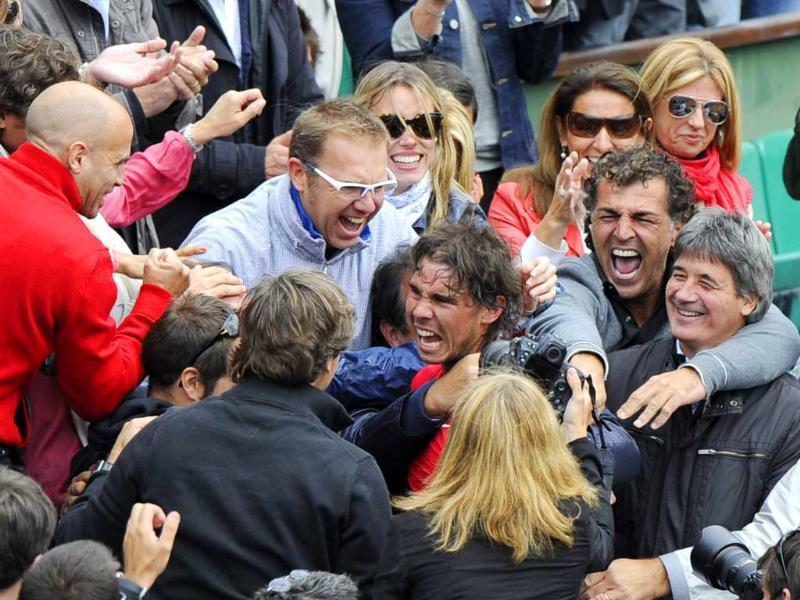 Spain's Rafael Nadal celebrates with his sister his staff members and his family after winning against Serbia's Novak Djokovic their Men's Singles final tennis match of the French Open tennis tournament at the Roland Garros stadium in Paris. (AFP photo/Pacal Guyot)