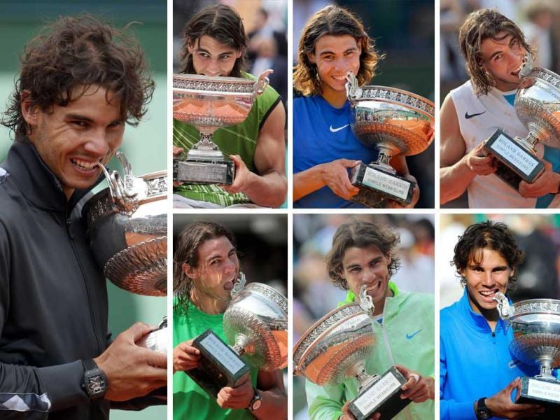A combination of AFP files pictures made in Paris, shows Spanish Rafael Nadal biting his trophy after his seven victories in the men's final matches of the French Open Tennis at the Roland Garros stadium. AFP Photo