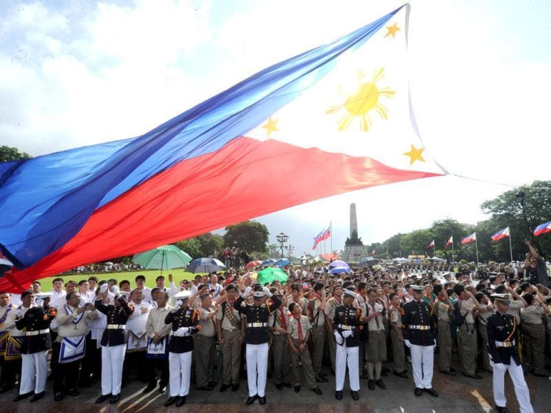 Philippine Marines raise the country's flag of the nation's 114th Independence Day celebrations in Manila on June 12, 2012. The Philippines declared independence from Spain in 1898, ending three centuries of Spanish rule. AFP/Jay Directo
