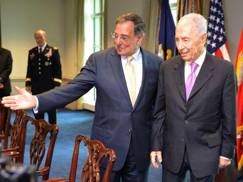 US defence secretary Leon Panetta shows Israeli President Shimon Peres his seat ahead of a meeting at the Pentagon in Washington. AFP/Mandel Ngan