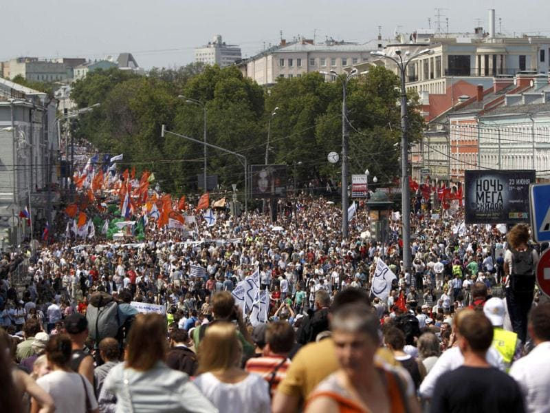 Participants march with flags and placards during an anti-government protest in Moscow. Reuters/Maxim Shemetov