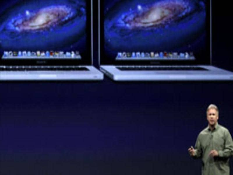 Phil Schiller, Apple's senior vice president of worldwide marketing, talks about new features to the company's laptops during the Apple Developers Conference in San Francisco, Monday, June 11, 2012. Apple says it's introducing a laptop with a super-high resolution