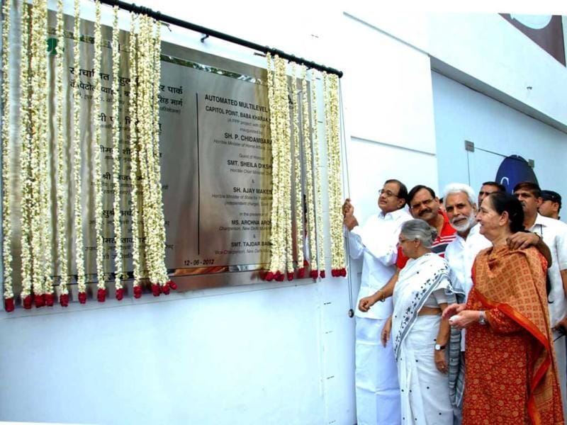 Home minister P Chidambaram and Delhi chief minister Sheila Dikshit unveil the plaque at Capitol Point in New Delhi. UNI