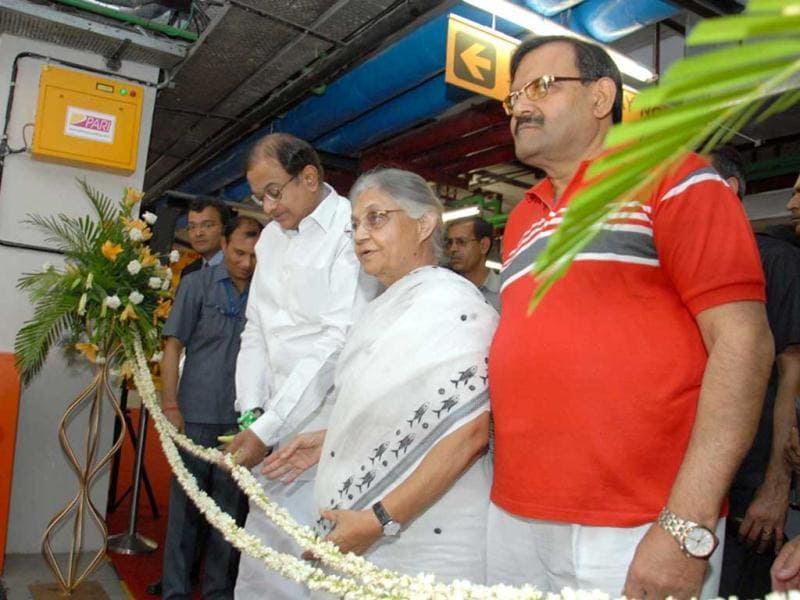 Home minister P Chidambaram and Delhi chief minister Sheila Dikshit inaugurate Capitol Point, automated multi-level parking in New Delhi. UNI