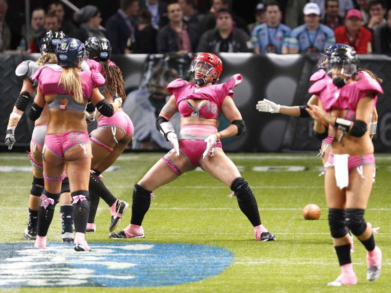 Sunshine Uli of the Western Conference celebrates her touchdown against the Eastern conference during a Lingerie Football League exhibition match at Olympic Park in Sydney. Reuters Photo/Daniel Munoz