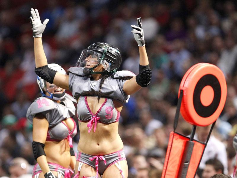 Angela Perfetto of the Eastern Conference celebrates a touchdown against Western Conference during a Lingerie Football League exhibition match at Olympic Park in Sydney. Reuters Photo/Daniel Munoz
