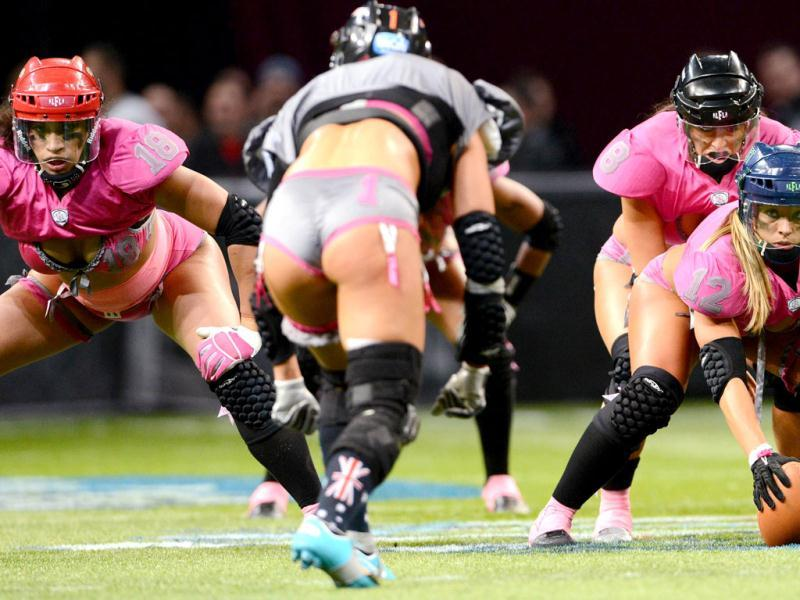 Western confernce player Christine Moore (R) prepares a move against the Eastern Conference players during their Lingerie Football League (LFL) All-Stars match in Sydney. AFP Photo/William West