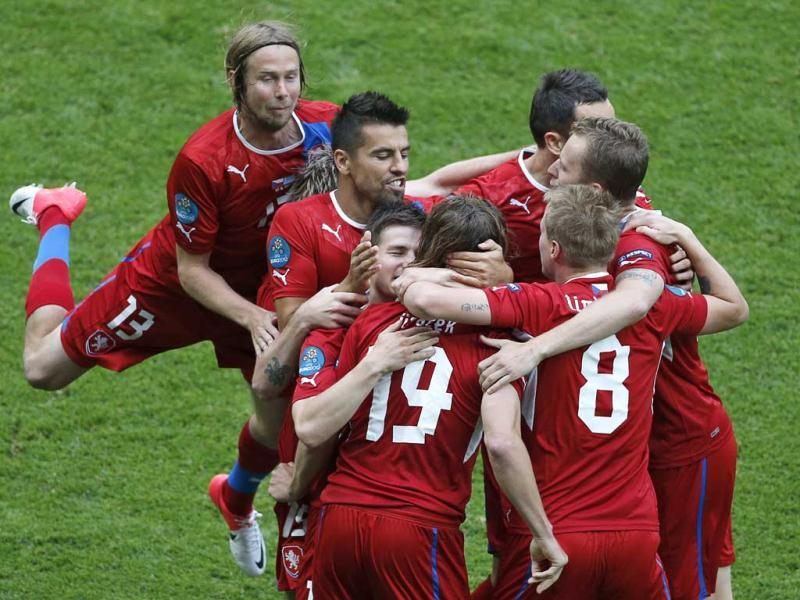 Czech Republic's Petr Jiracek, front left, is congratulated by teammates after scoring the opening goal during the Euro 2012 soccer championship Group A match between Greece and Czech Republic in Wroclaw, Poland. AP/Anja Niedringhaus