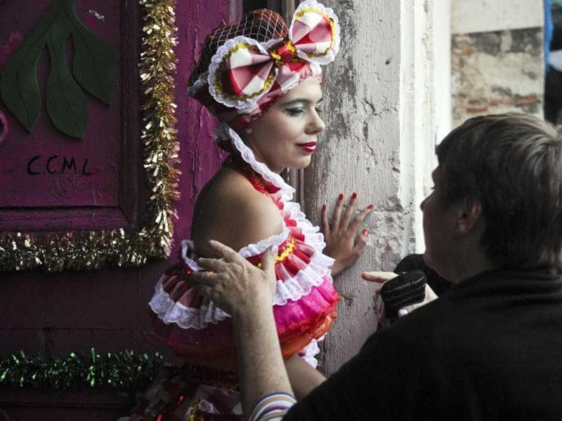 A reveler from a typical Lisbon neighbourhood, Alfama, says goodby to her mother moments before going to the Saint Anthony's Parade on Avenida da Liberdade, in Lisbon. Lisbon celebrates Saint Antony's day, its protector, with a parade that gathers participants from several typical neighborhoods of the city. AFP Photo/Patricia De Melo Moreira