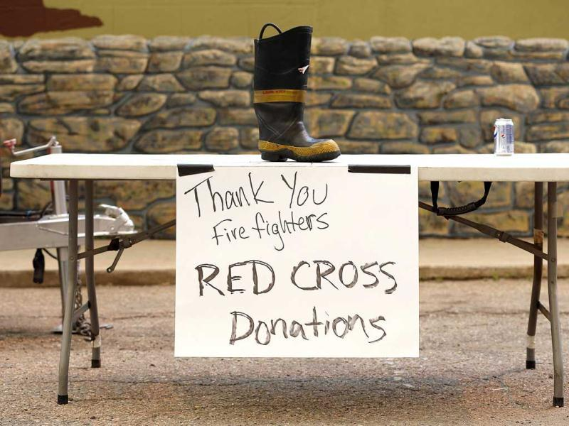 A firefighter's boot sits on a table for donations to the Red Cross outside the Double S Bar in Laporte, Colorado. At least 18 structures were lost or damaged due to the fire with more threatened and officials are searching for one person believed to be missing. Reuters/Marc Piscotty