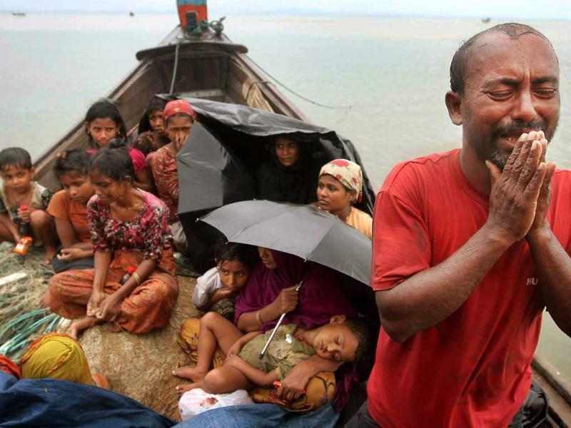 A Rohingya Muslim man who fled Myanmar to Bangladesh to escape religious violence, cries as he pleads from a boat after he and others were intercepted by Bangladeshi border authorities in Taknaf, Bangladesh. AP Photo/Anurup Titu