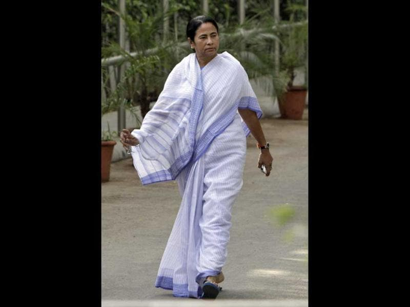 Mamata Banerjee, chief minister of West Bengal, walks after her meeting with chief of Congress party Sonia Gandhi, at her residence in New Delhi. Banerjee met Gandhi to discuss possible party candidates for the post of the President of India. (Reuters)