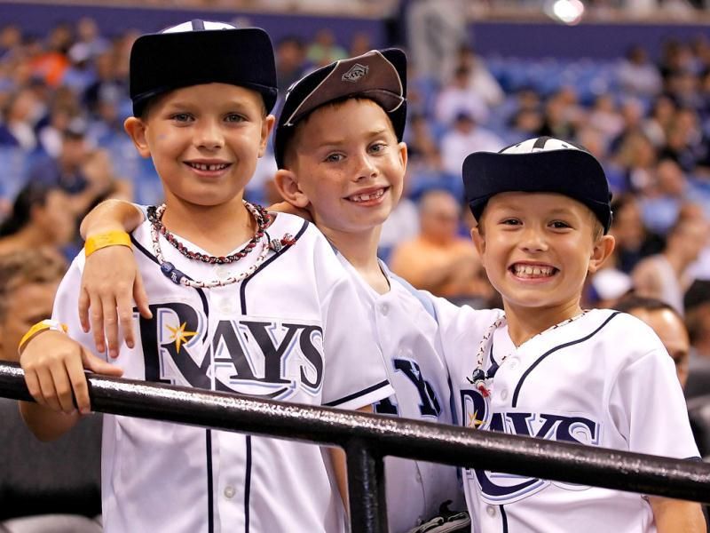 Fans of the Tampa Bay Rays have their rally caps on in the ninth inning againstof the New York Mets at Tropicana Field in St. Petersburg, Florida. AFP/J Meric