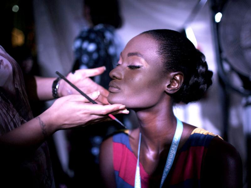 Senegalese model Aminata Faye has her make-up done backstage between shows during the 10th anniversary of Dakar Fashion Week. Reuters/Finbarr O'Reilly