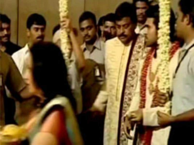 Ram Charan Teja arrives with dad Chiranjeevi for the wedding.