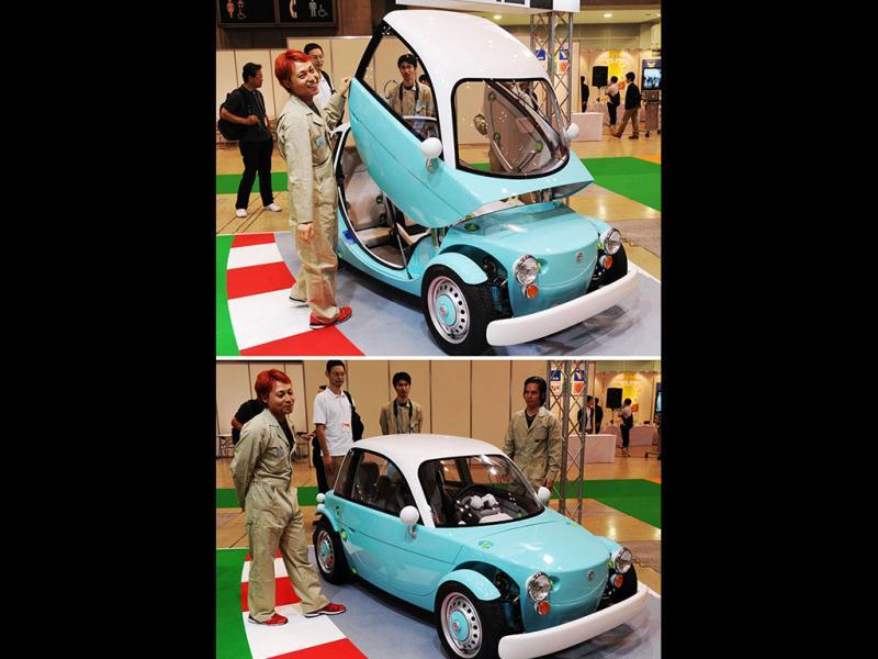 This combo picture shows Japanese auto giant Toyota Motor's concept model of a three-seater electric vehicle with toy-like design body