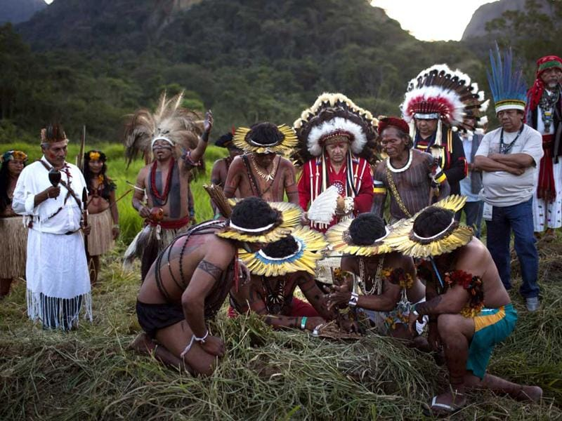 Indigenous people from several tribes participate in the Sacred Fire Lighting Ceremony at the Kari-Oca village, during the United Nations Conference on Sustainable Development, or Rio+20, in Rio de Janeiro, Brazil. AP Photo/Felipe Dana