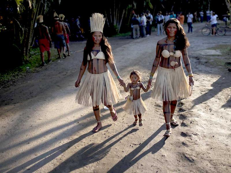 Members of the Xerente tribe walk at the Kari-Oca village during the United Nations Conference on Sustainable Development, or Rio+20, in Rio de Janeiro, Brazil. AP Photo/Felipe Dana