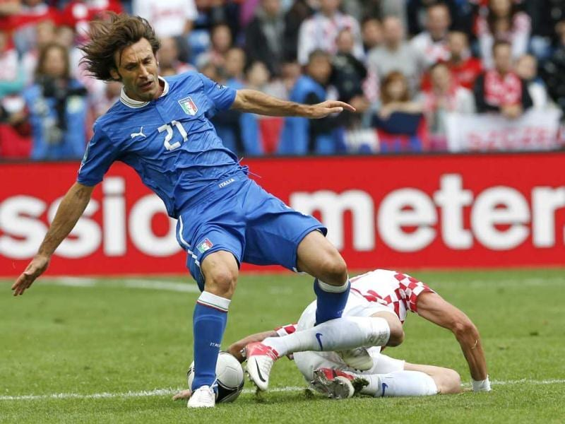 Italy's Andrea Pirlo, left, is fouled by Croatia's Mario Mandzukic during the Euro 2012 soccer championship Group C match between Italy and Croatia in Poznan, Poland. AP/Antonio Calanni