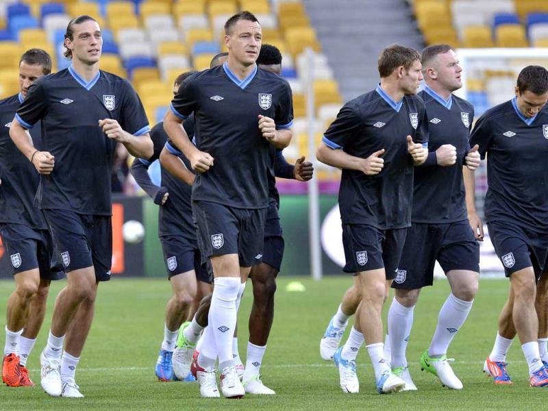 England's John Terry, 3rd from left, exercises with the team during the official training on the eve of the Euro 2012 soccer championship Group D match between Sweden and England in Kiev, Ukraine. AP Photo/Martin Meissner