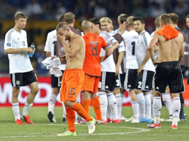 Wesley Sneijder from the Netherlands leaves the pitch after the Euro 2012 soccer championship Group B match between the Netherlands and Germany in Kharkiv, Ukraine. AP Photo/Matthias Schrader