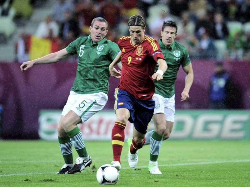 Spain's Fernando Torres moves past Ireland's Richard Dunne and Sean St Ledger to score during the Euro 2012 soccer championship Group C match between Spain and Ireland in Gdansk, Poland. AP/Alvaro Barrientos