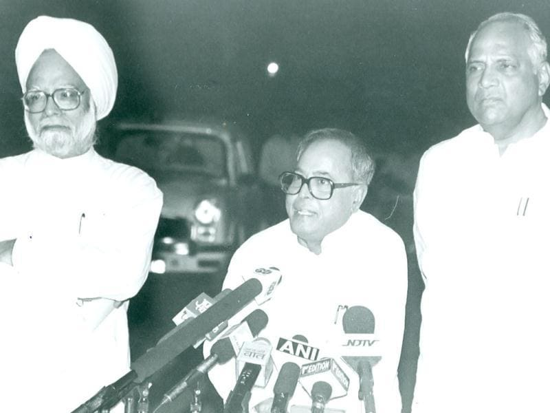 PM Manmohan Singh and NCP chief Sharad Pawar are seen in this file photo with Pranab Mukherjee.