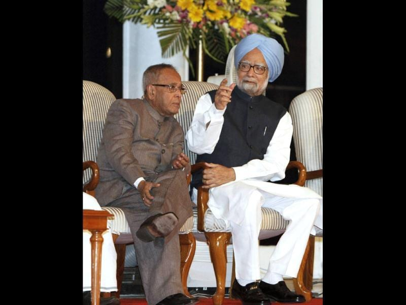 Pranab Mukherjee is seen with PM Manmohan Singh at UPA II's anniversary in New Delhi. (Reuters)