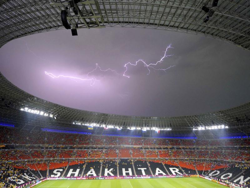 The lightning is seen on the sky above the Donbass Arena during the Group D Euro 2012 soccer match Ukraine vs France in Donetsk. Reuters/Felix Ordonez